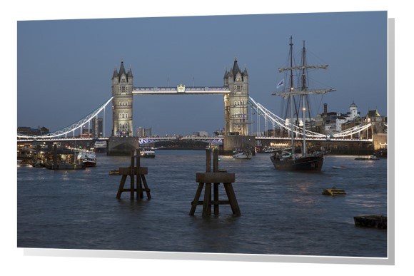 Tower Bridge crossing River Thames at dusk in London, England